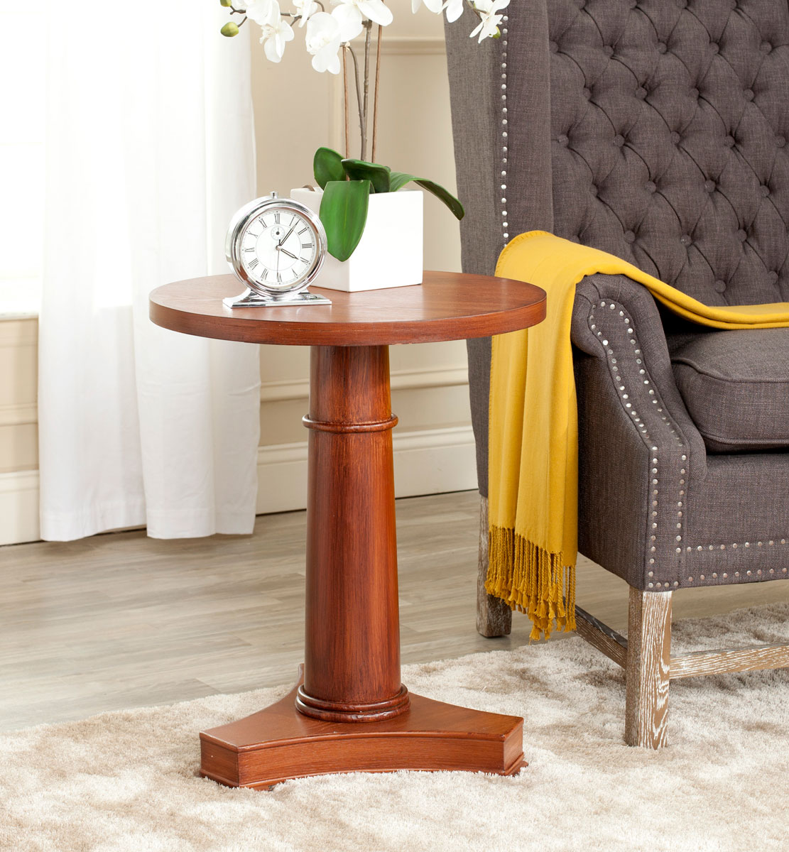 79653337a95f Crafted with fir wood in a warm brown finish with detailed baluster base