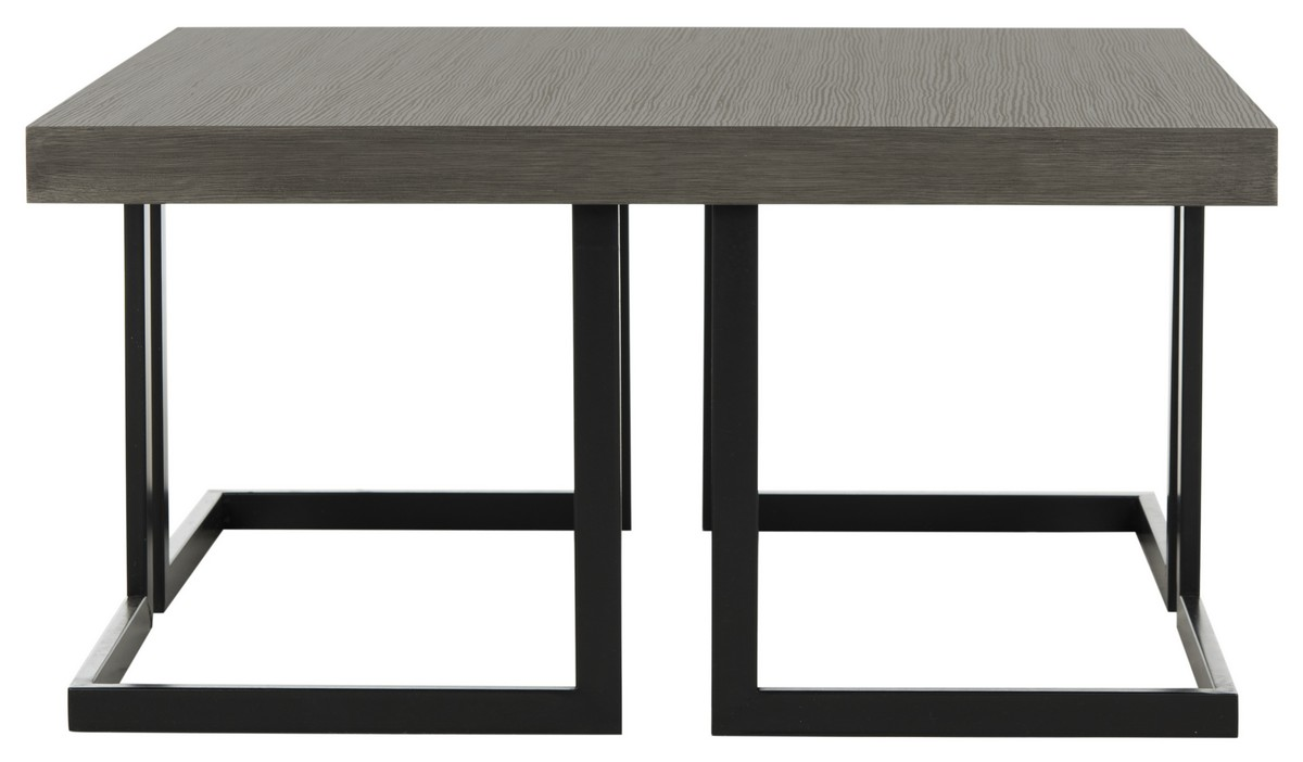 Bangkok inspired this modern coffee table bold and solid the dramatic graphic lines of its metal base are paired with a sleek top with dark grey
