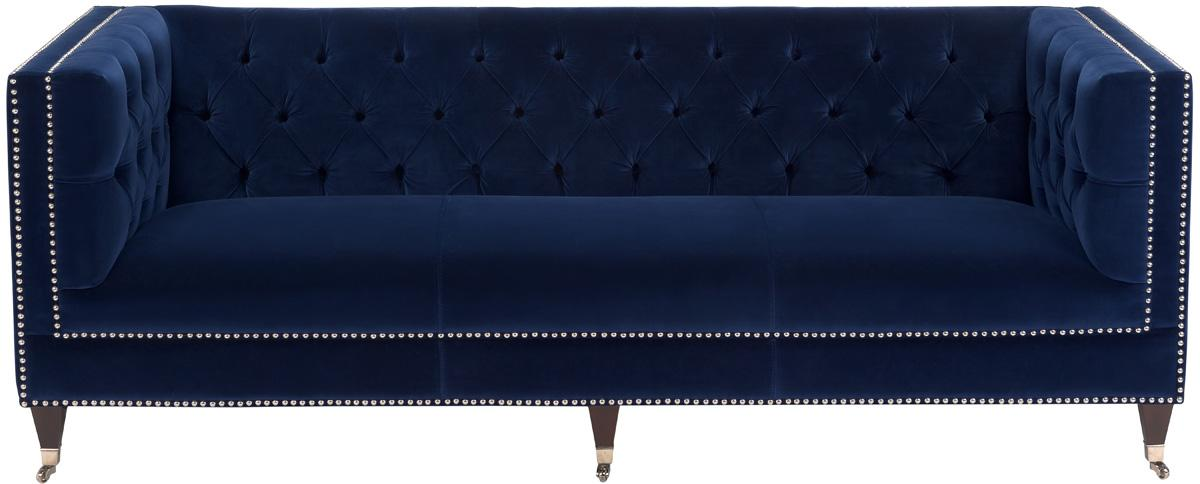 evoking hollywood glamour with its tuxedo style and luminous navy blue velvet upholstery the miller sofa is richly biscuit tufted on its back