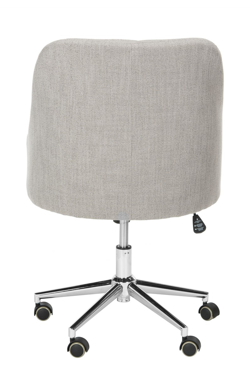 inspired by the office of a top fashion blogger this tufted linen chrome leg swivel office chair puts a new spin on classic barrel chair