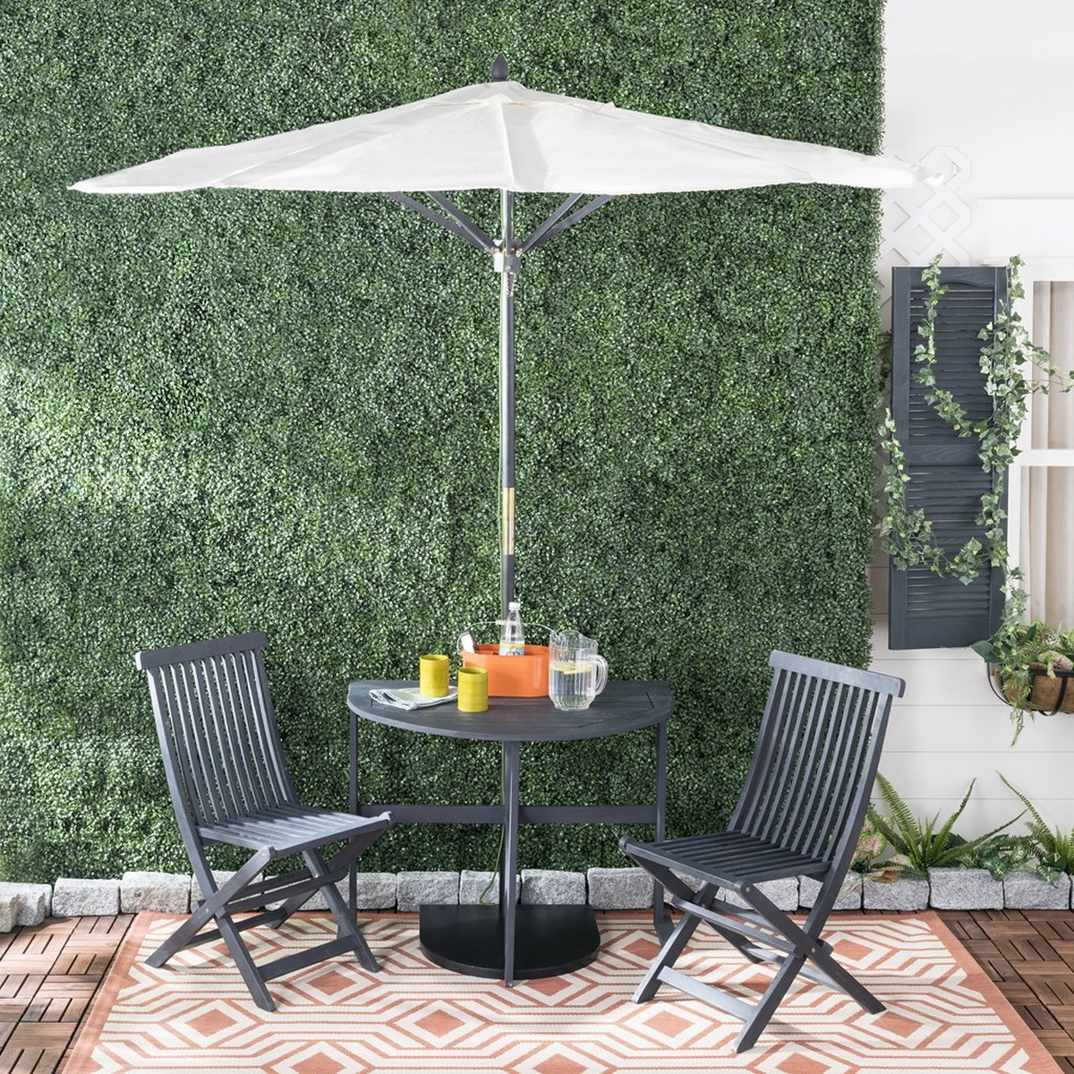 Half Patio Set Brings Bistro Style Charm To Any Outdoor Living Area Sheltered By A Bold Navy Umbrella Its Acacia Wood Features Natural Teak Finish
