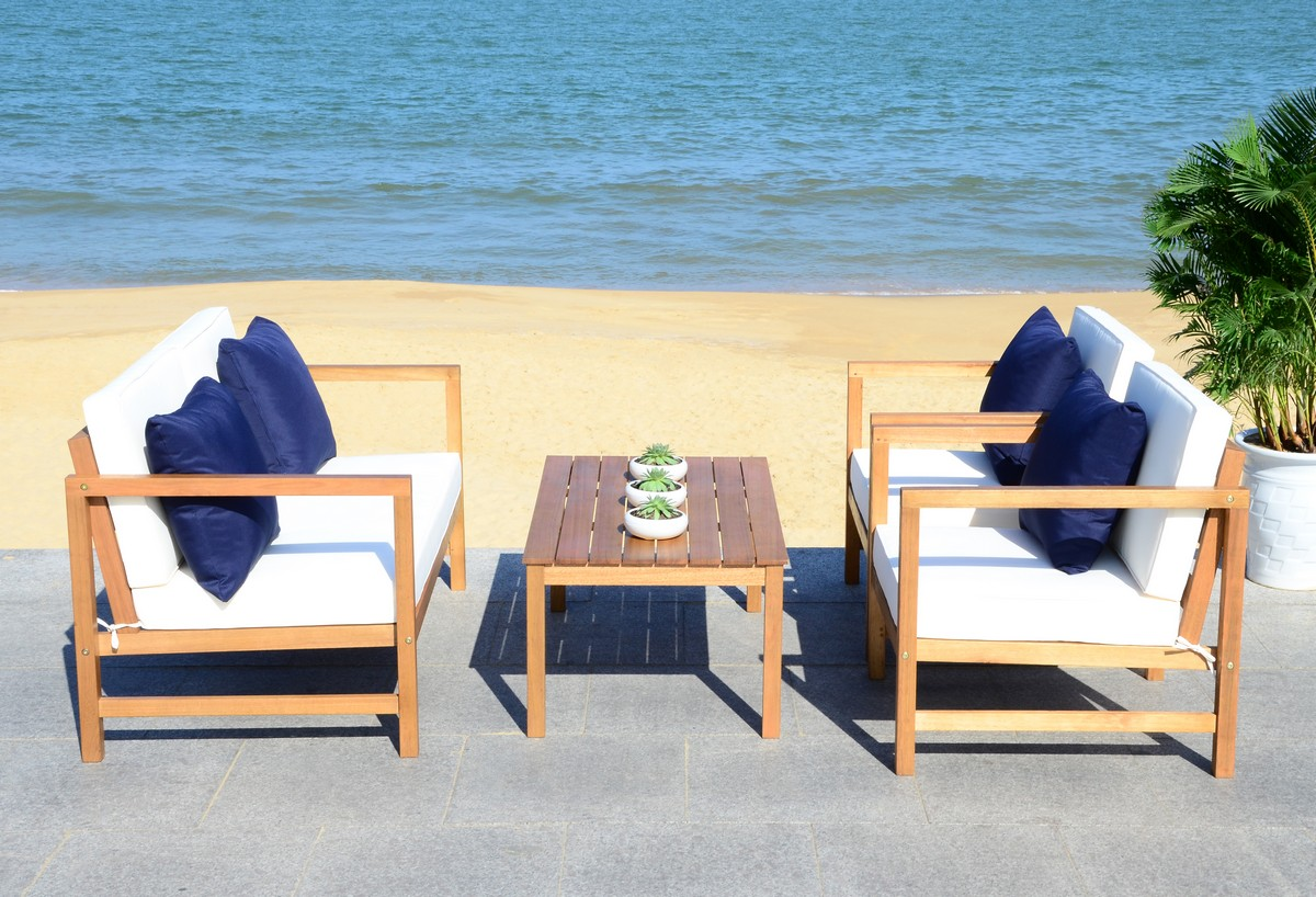 Outdoor set was inspired by the home of las top interior designer crafted in a natural hue its sleek lines are illuminated with white upholstery that