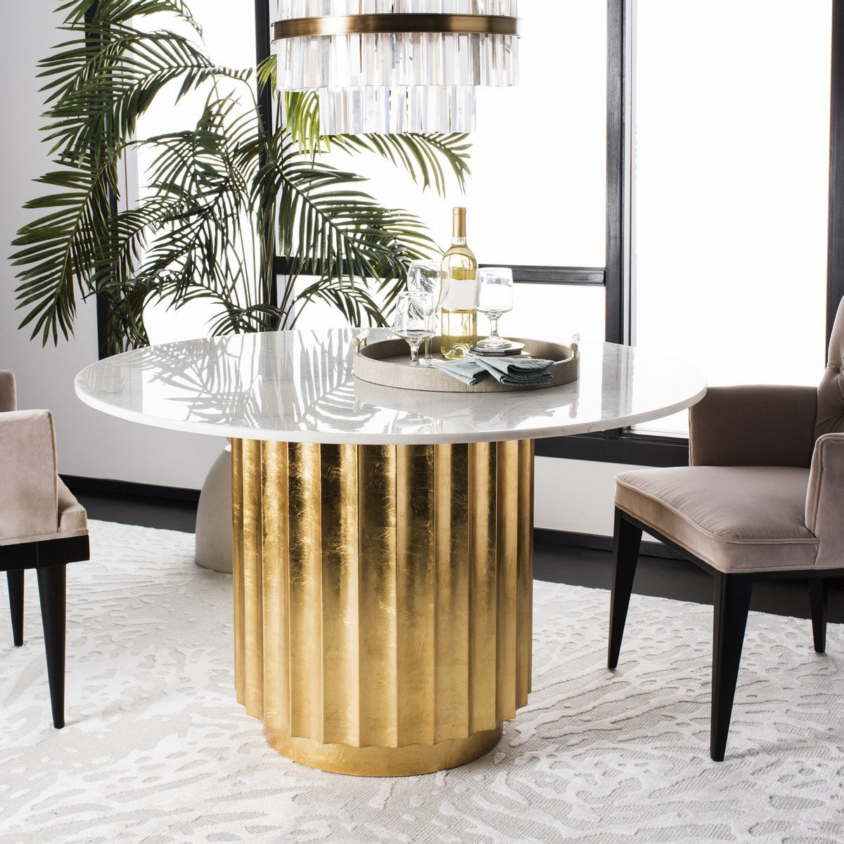 Its Bold Stature Brings Drama And Character To Any Dining Room With Carved Sculptural Base Clic Gray Marble Top A Designer Touch Gold Leaf