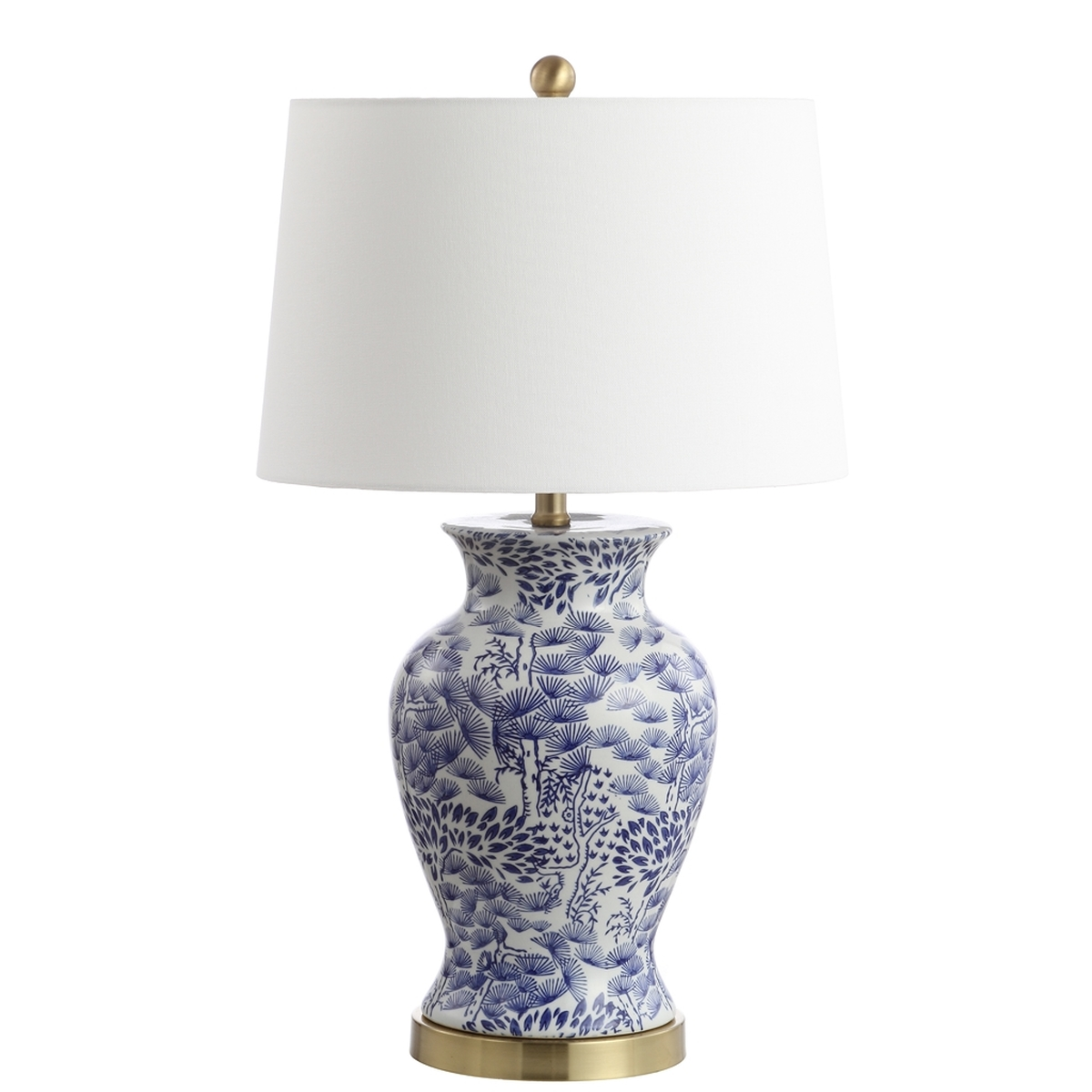 Living room with this classic table lamp rich blue flowers illuminate its white ceramic curves while a crisp complimentary 100 cotton off white shade
